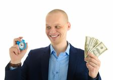Excited Businessman with alarm clock and stack of cash in hand. Time is money concept. Excited Businessman with alarm clock and stack of cash in hand. Time is Royalty Free Stock Photography