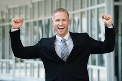 Excited Businessman With Arm Raised Royalty Free Stock Image