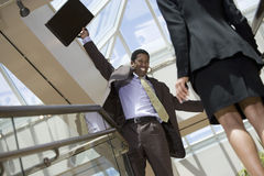 Excited Businessman With Arms Outstretched Stock Image