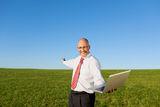 Excited Businessman With Arms Outstretched Holding Laptop On Fil Royalty Free Stock Photo
