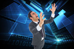 Excited businessman with arms raised. Composite image of excited businessman with arms raised Stock Images