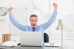 Excited businessman with arms up cheering Royalty Free Stock Photo