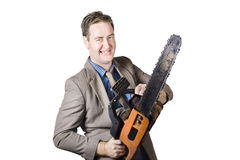 Excited Businessman With Chainsaw Stock Photos