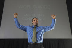 Excited Businessman In Conference Room Royalty Free Stock Photography