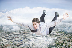 Excited Businessman Flying In The Clouds Royalty Free Stock Photography