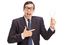 Excited businessman holding a light bulb Royalty Free Stock Photos