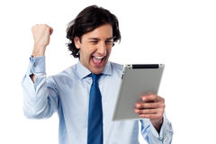 Excited businessman holding touch pad Stock Images