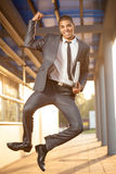 Excited businessman jumping, celebration success deal,outdoor sh. Businessman jumping, happy about the successful conclusion of a business deal Royalty Free Stock Image