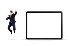 Excited businessman jumping with empty billboard. Excited asian businessman jumping with empty billboard isolated on white background Stock Image
