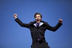 Excited businessman jumping. Happy businessman jumping into the air Stock Images