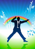 Excited businessman jumping on rainbow background Stock Photo