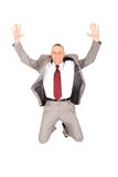 Excited businessman jumping because of success Royalty Free Stock Photography