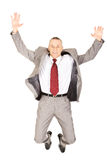 Excited businessman jumping because of success Stock Photography