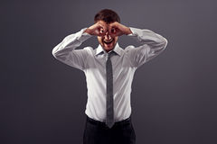Man looking through imaginary binocular Royalty Free Stock Photos