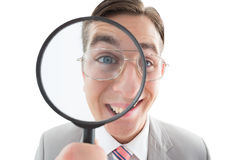 Excited businessman looking through magnifying glass Royalty Free Stock Photos