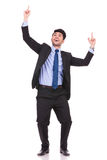 Excited businessman pointing fingers and looking up Royalty Free Stock Photo