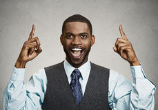 Excited businessman pointing with fingers up Stock Photography