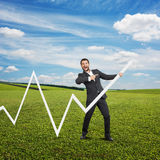 Excited businessman pointing. At white pointer and laughing. photo at outdoor Stock Photo