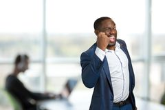 Excited businessman raised his fist. Royalty Free Stock Images