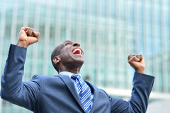 Excited businessman raising his arms Stock Photography