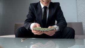 Excited businessman receiving big loan from bank and smiling, successful startup. Stock photo royalty free stock photo