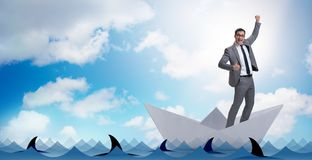 The excited businessman riding paper ship boat Stock Images