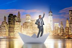 The excited businessman riding paper ship boat Stock Photos