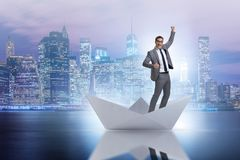 The excited businessman riding paper ship boat Royalty Free Stock Photos