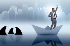 The excited businessman riding paper ship boat Stock Photography
