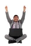 Excited businessman. Sat cross-legged on the floor Royalty Free Stock Photos