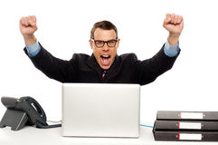 Excited businessman shouting and rejoicing Royalty Free Stock Images