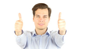 Excited businessman showing thumbs up Stock Photography