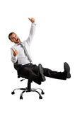 Excited businessman sitting on chair Royalty Free Stock Images