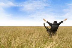 Excited businessman sitting outdoor Stock Images