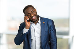 Excited businessman speaking on mobile. Stock Images