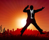 Excited businessman on sunset background Stock Photo