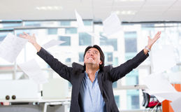 Excited businessman throwing papers Royalty Free Stock Photos