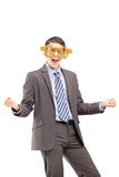 Excited businessman wearing dollar sign glasses and gesturing ha Royalty Free Stock Photography