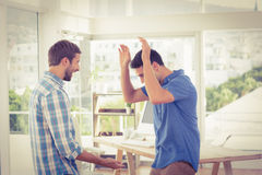 Excited businessmen clapping their hands Stock Photos