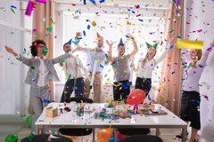 Excited Businesspeople Having Fun Raising Their Arms. Among Party Confetti stock photos