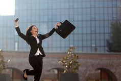 Excited businesswoman. A businesswoman reacts after hearing exciting news Stock Photography