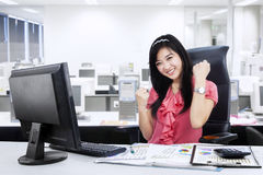 Excited businesswoman celebrating her success Royalty Free Stock Image