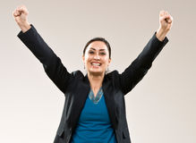 Excited businesswoman cheering Stock Photography