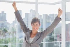 Excited businesswoman cheering and smiling Royalty Free Stock Image