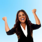 Excited businesswoman with clenched fists. Businesswoman clenching her fists in excitement Stock Image