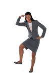 Excited businesswoman dancing against white background Stock Photo