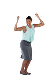 Excited businesswoman dancing against white background Stock Images