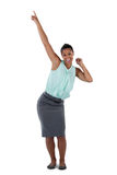 Excited businesswoman dancing against white background Stock Photos