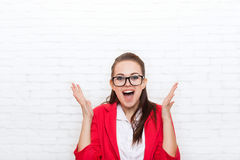 Excited businesswoman happy smile wear red jacket glasses Royalty Free Stock Photography