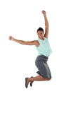 Excited businesswoman jumping in the air Royalty Free Stock Images